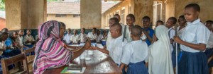 Drug distributors distribute drugs at a school to children