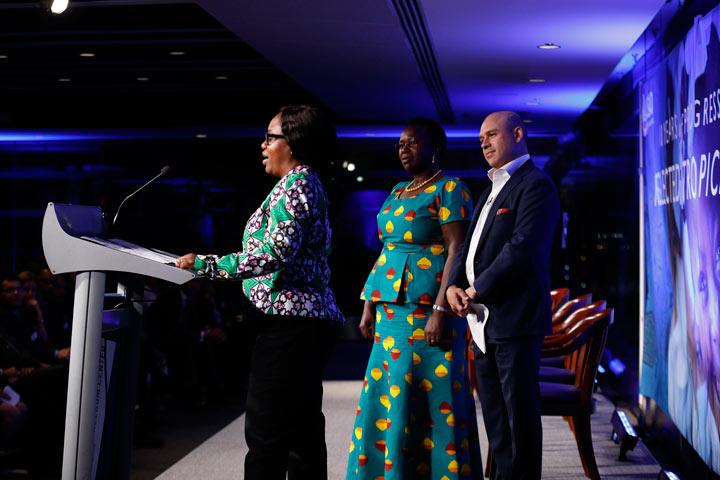 Three people at podium