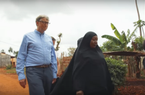 Bill Gates walking with a woman