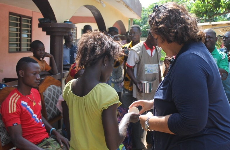 The US Deputy Chief of Mission to Togo provides medicines to villagers.