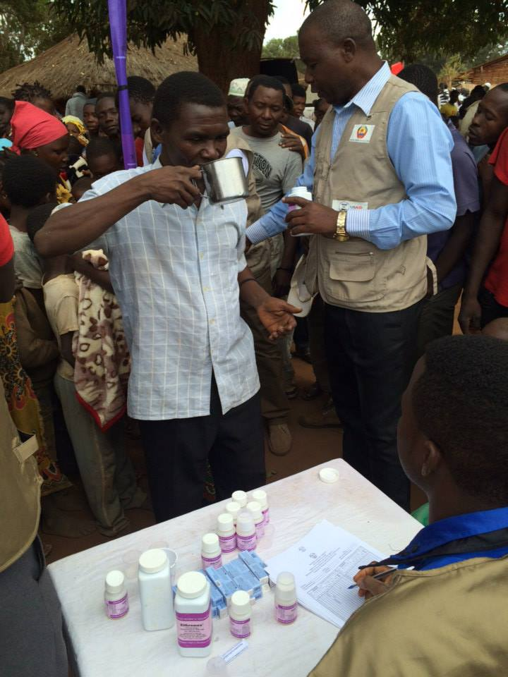 Villagers begin to take their medications to help prevent trachoma in Ancuabe, Cabo Delgado, Mozambique.