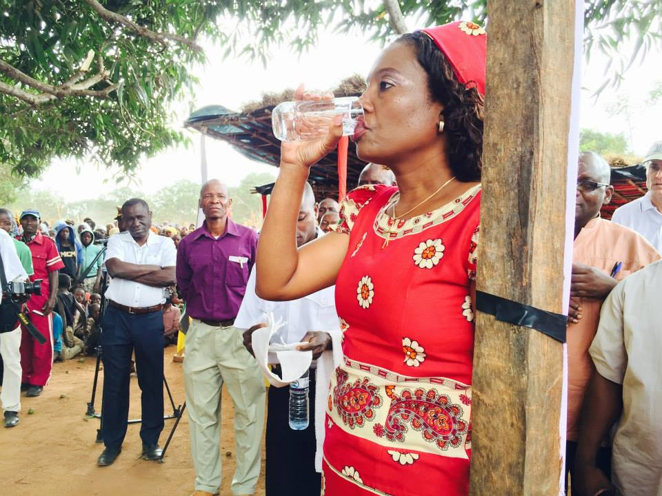The Provincial Governor takes a dose of the drug used to treat trachoma in Ancuabe, Cabo Delgado, Mozambique.