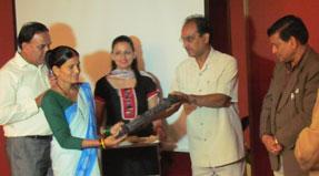 Woman receiving an award