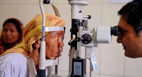 Shiva Lal Rana, left, getting a checkup at the Geta Eye Hospital in Nepal. Photo credit: Poras Chaudhary for The New York Times