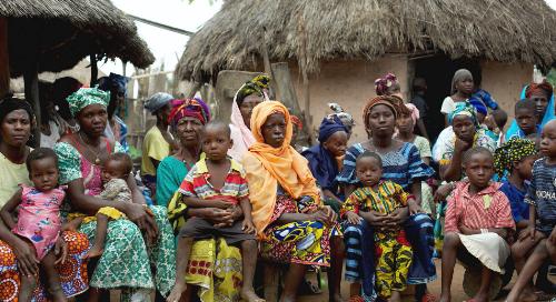 A group of women and children in Faranah, Guinea; Photo Credit: RTI International/Patrick Adams